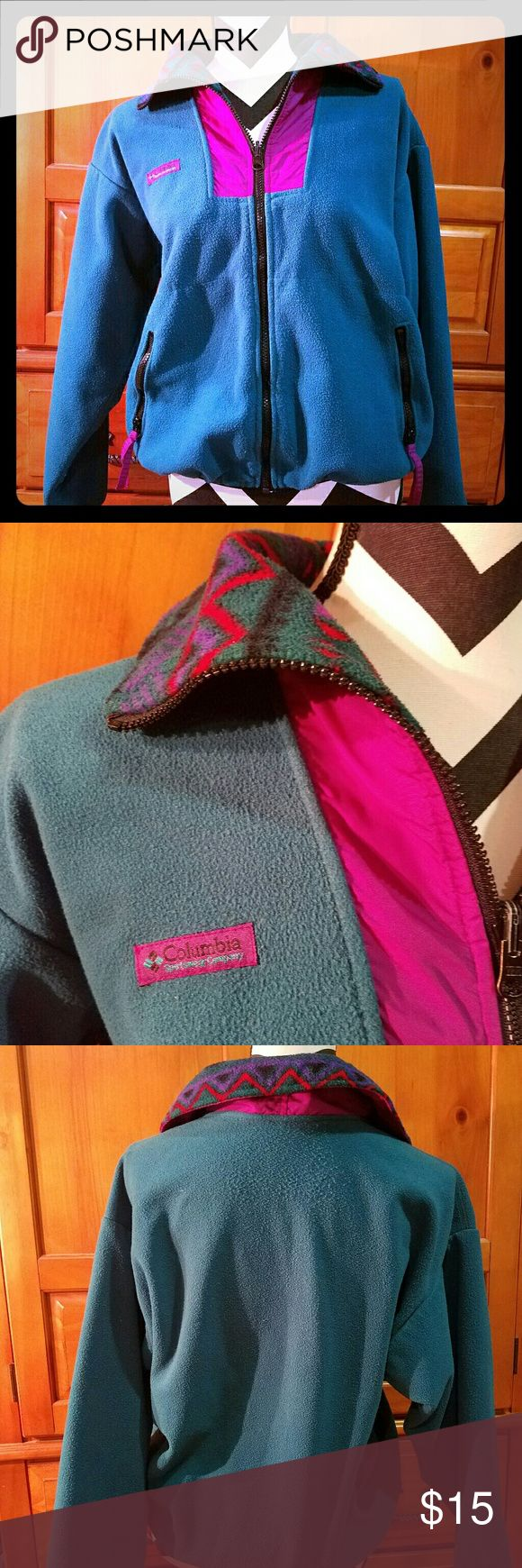 Vintage Tribal Aztec Zip Up Columbia size Medium size medium vintage Columbia zip up sweater.  It is a green/teal color.  There are two front zippered pockets.  The collar features an aztec tribal design.  This sweater is vintage and well loved, there are signs of normal wear and tear.  Please see the photos.  There are no rips or stains.  This comes from a smoke free home. Columbia Sweaters