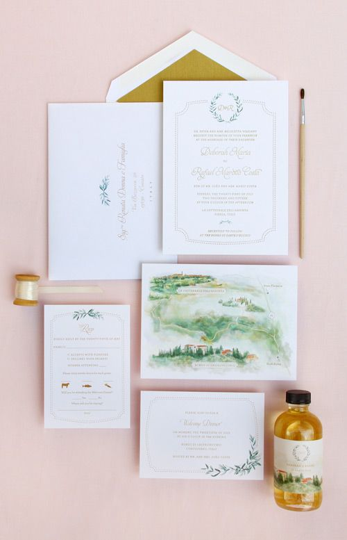 Custom wedding invitation featuring Italian countryside and olive branch watercolor illustrations.