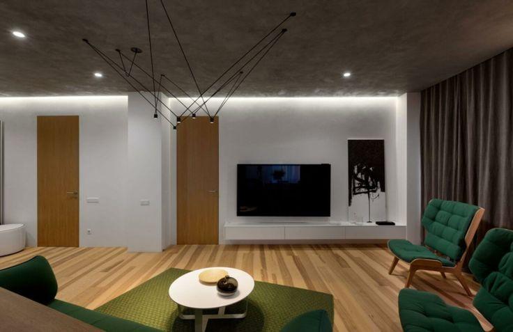 farbe-grün-deko-teppich-khaki-wohnwand-schlicht-lowboard - wohnzimmer farbe grun