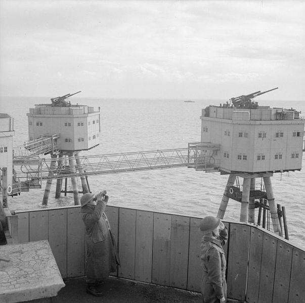 Anti-aircraft crews scan the sky from a Maunsell sea fort in the Thames Estuary, 19 November 1943.