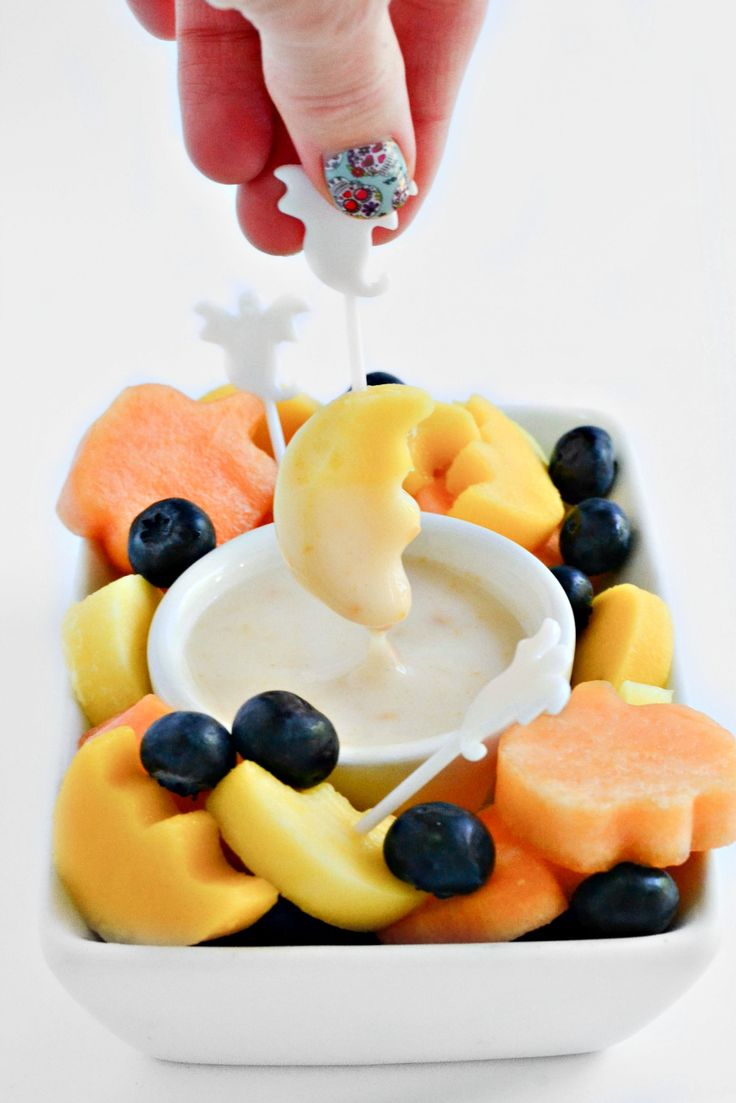 Fruit, cut up in Halloween-inspired shapes, dipped into a #vegan coconut yogurt and peanut butter dip. It doesn't get any easier than this #Halloween Fruit Dip!
