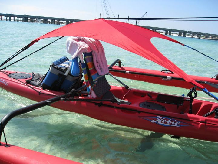 shade sail for your canoe or kayak. I'd love be this except don't think it'd work going down class 3 rapids for a week. Sure would be great though