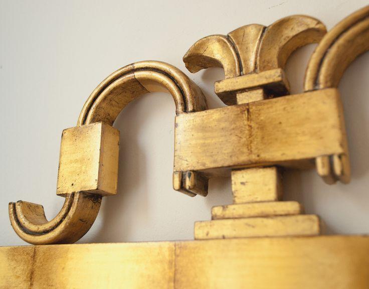 Detail of Swedish Art Deco gilt-wood mirror by Axel Einar Hjorth.