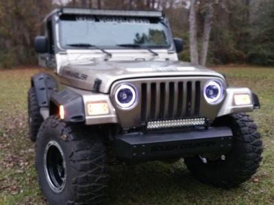 Calvin's 2003 Jeep Wrangler Sahara with Black Headlights Halo and Clear Bumper Lights Side Marker