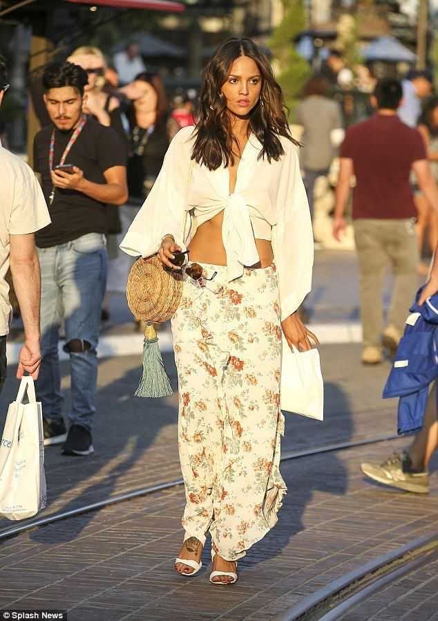 Mexican goddess: Eiza Gonzalez showed off her incredibly toned body on Thursday in a whimsical crop top with long flowing sleeves