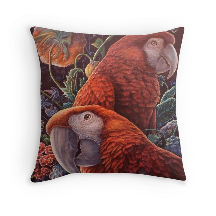 This pillow design has two beautiful red macaw parrots in a garden full of fresh flowers.