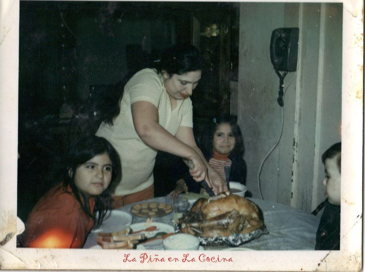 There is my beautiful Mom slicing the turkey. That's me next to her on the…