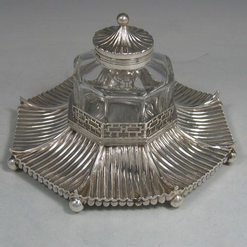 Antique Victorian sterling silver 'Chinese Pagoda' style inkstand made by George Lambert of London in 1891. Diameter 19 cms, height 12 cms.