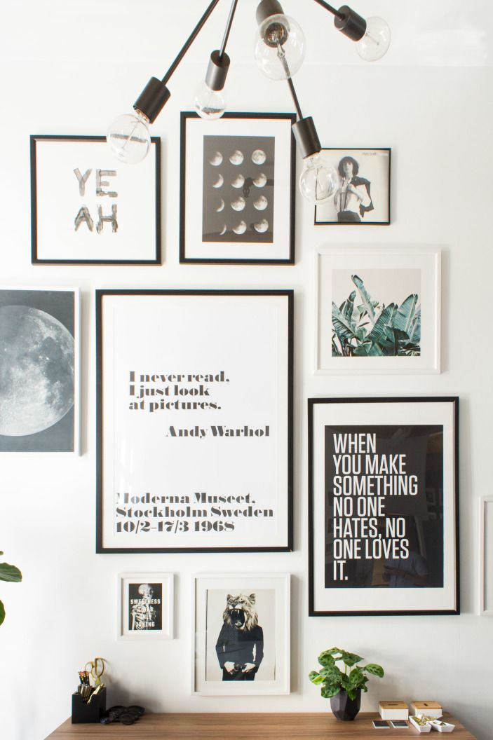 """In Katie's office, typographic posters and artwork take advantage of the high ceilings. The quotes are by Andy Warhol and Tibor Kalman. It's one of Katie's favorites, as she says: """"It speaks to the aesthetics that inspire me: graphic prints and textures, bold photography, simple typographical treatments and creative references."""""""