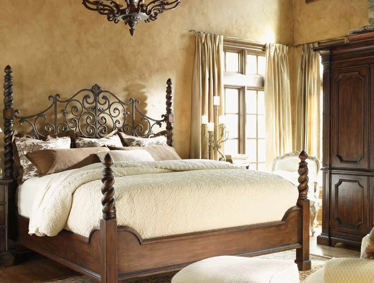 Love the gold walls, the Tuscan texture, and the classic bedding!