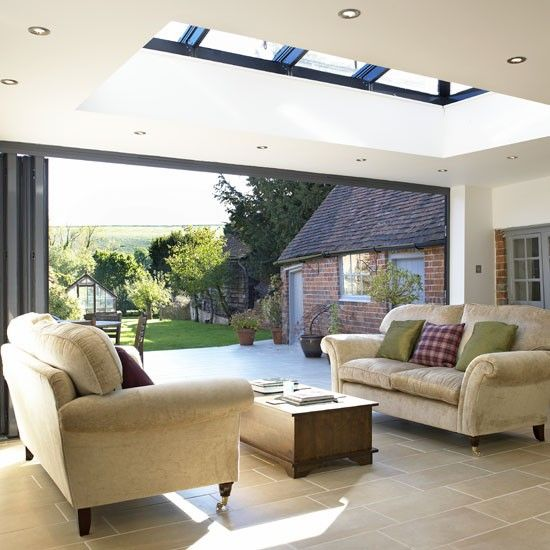 Enjoy a whole wall of light by fitting folding sliding doors. This bespoke orangery includes a five-panel folding door system, and is lit from above by a rooflight.