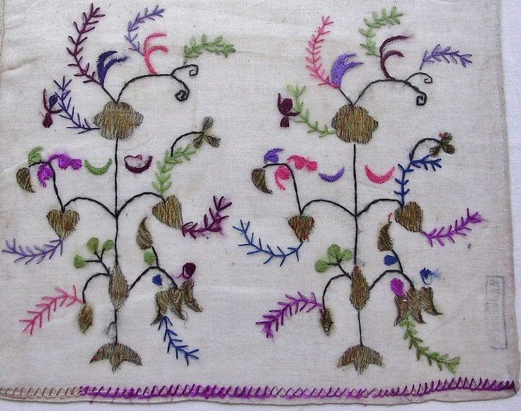 One end of an 'uçkur' (woman's sash / waist band) with embroidered ends.  Crimean Tatar, probably from Romania, ca. 1900.  Cotton (muslin), 28 x 168 cm.  Featuring a 'Tree of Life' motif. Height of the embroidery (from the tip of flower to edge of cloth: 22 cm. On the back of cloth there is stamp, in Russian, indicating the Crimean origin of the sash.  (The Asiye-Zeynep Collection, Washington DC).