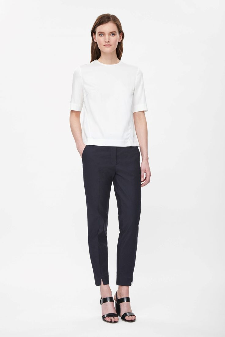 A neat, tailored fit with a slight stretch, these cotton-mix trousers have a subtle split hem and tactile textured finish. Designed to sit just below the waist and tapering at the ankle, they have crisp press folds, slanted front pockets and a zip fly fastening.