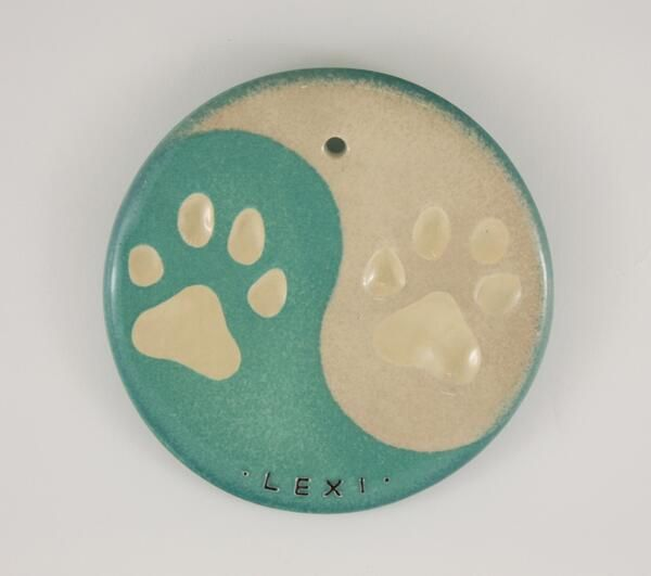 Aqua and beige ying yang on this personalized paw impression for Lexi