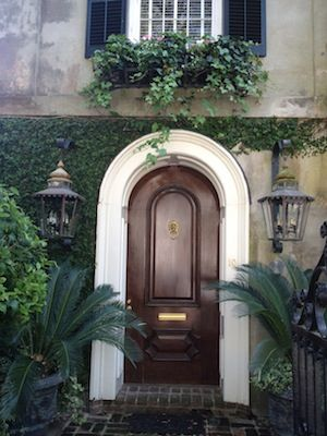 Beautiful arched wooden door in Charleston.  Love the brick porch. If you love beautiful homes, gardens, parks, great restaurants, you should visit Charleston, SC.
