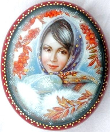 Russian lacquer miniature from the village of Fedoskino. A pretty girl in a traditional shawl and mittens.