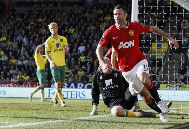 Manchester United's Ryan Giggs (right) celebrates after scoring in the English Premier League soccer match against Norwich City at Carrow Road in Norwich yesterday