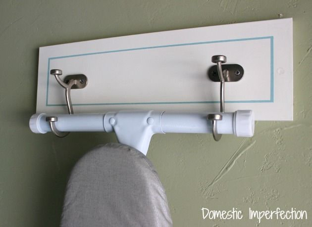 DIY wall mount ironing board hanger - easy project and costs less than $10!