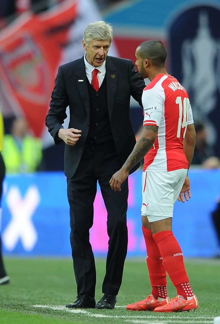 Arsene Wenger the Arsenal manager gives Theo Walcott some instructions as he prepares to come on as a substitute. The FA Cup Semi Final between Reading and Arsenal at Wembley Stadium on April 18, 2015.