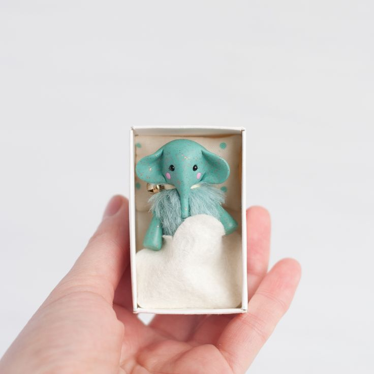 you know that all my #miniature #toys have a #bed in a #matchbox, along with a blanket and a pillow. this elephant has a #cloud shaped blanket and pillow with dots or #drops also you always can add tiny #backpack