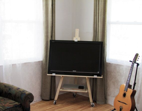 A very modern TV stand/easel for sale. European style, solid wood, unfinished, on casters for easy moving around a room. Excellent addition to a city