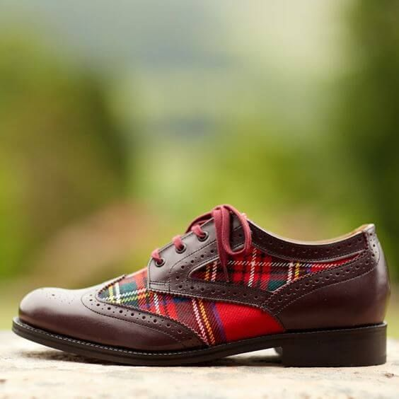 Style Tip! The Brogue shoe originated from Ireland and the Scottish Highlands. They were often worn to cross marshy land or to ford a stream. The decorative punching's that are now seen on todays Brogues were once actual holes and slashing's to allow the water to drain out of the shoes.     Photo credit to: http://www.scotlandshop.com/p-115-mens-tartan-brogues.aspx /  Scotland Shop (http://www.scotlandshop.com/p-115-mens-tartan-brogues.aspx)
