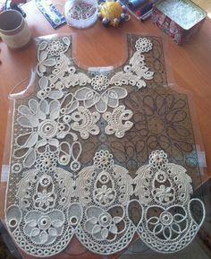 Crochet cord lace with Irish crochet motifs and needle-weaving