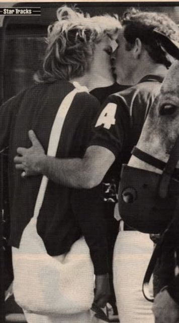 Charles and Diana kissing at a polo match