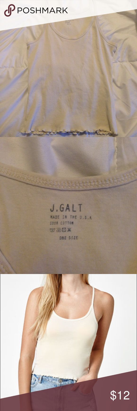 Brandi Melville Cami Top Pastel yellow cami top I purchased from Pacsun. Practically new, Worn once. One size.  Why does the tag say J. Galt? J. Galt is the same company as Brandi Melville. Brandy Melville Tops Tank Tops