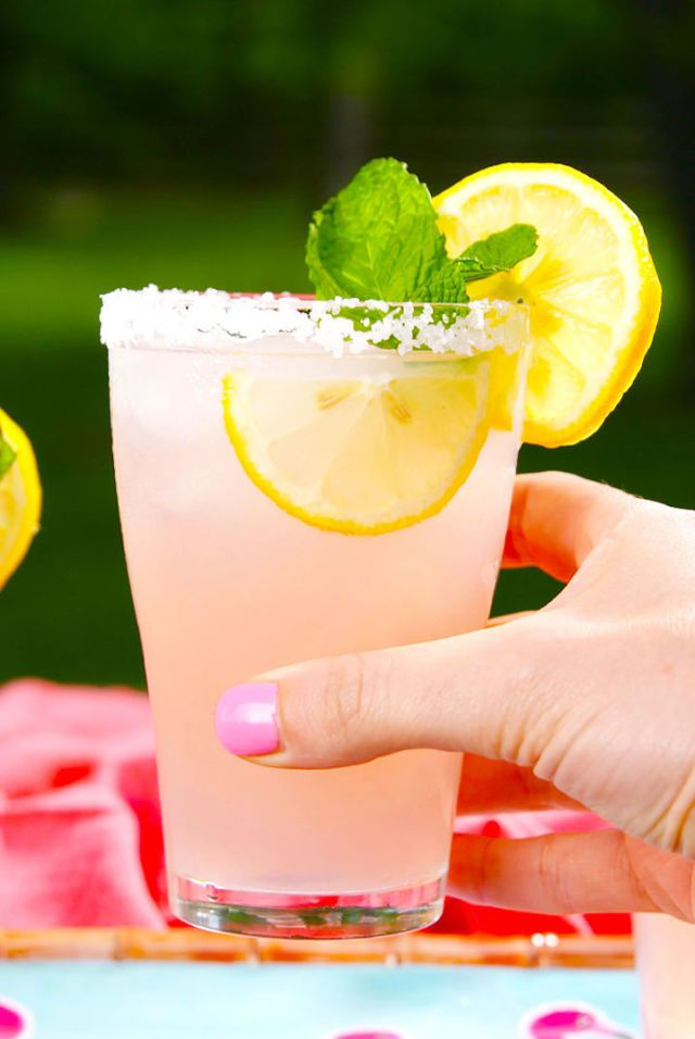 Pink Señoritas  - Margarita's sassy sister Lemon wedge, for rimming glasses Coarse salt, for rimming glasses 2 c. ice 2 c. Pink lemonade 1/4 c. fresh lemon juice 1/4 c. triple sec 1 c. tequila 4 Lemon Slices, for garnish