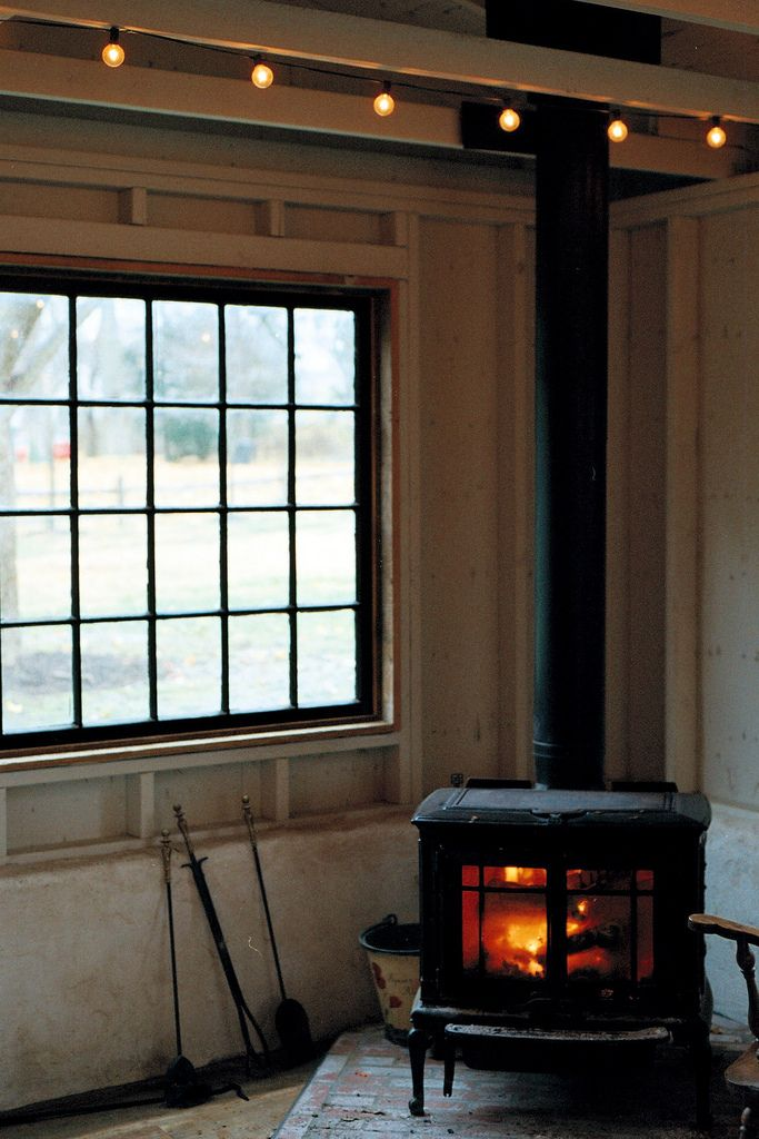 Woodstove  on corner and in front of large window