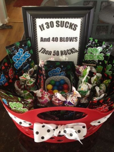 Candy basket that proves things get better with age if 30 sucks, and 40 blows, then 50 rocks.  See more 50th birthday gag gifts and party ideas at www.one-stop-party-ideas.com