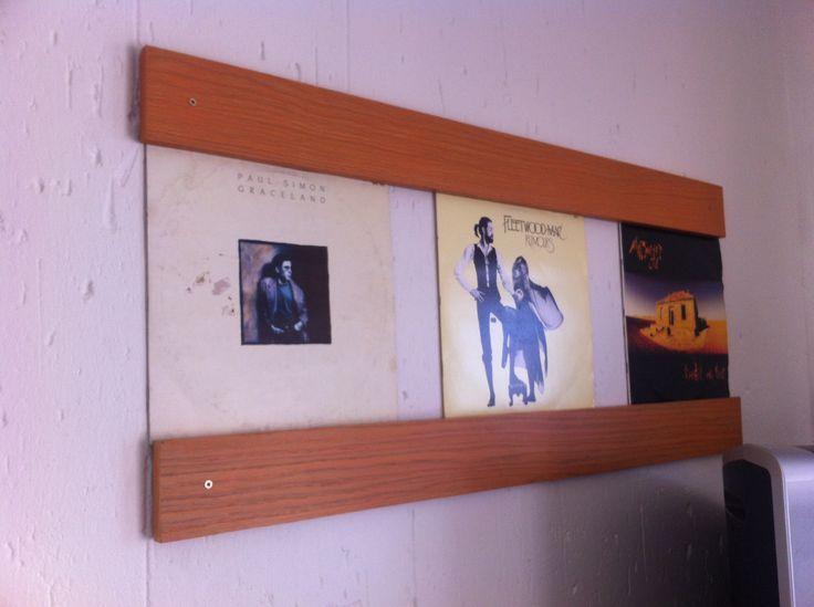 LP wall racks from reclaimed veneered chipboard paneling.