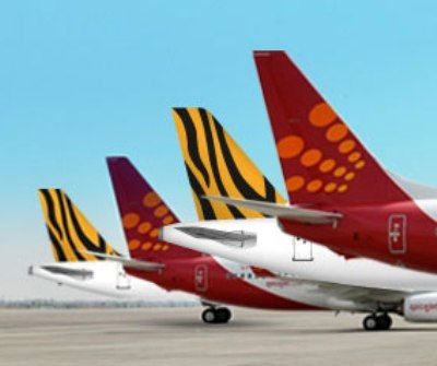"""low cost carrier and air asia Budget airline group airasia plans to add around 30 jets to its airline affiliates  across asia  """"we know what we are good at - low cost,"""" he said."""