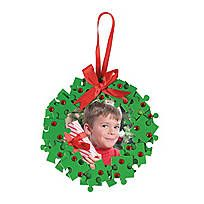 Handprint Snowflake Picture Frame Christmas Ornament Craft Kit. Trace each child's hand on the foam and cut out. All other pieces are pre-cut. 6 1/2; ...