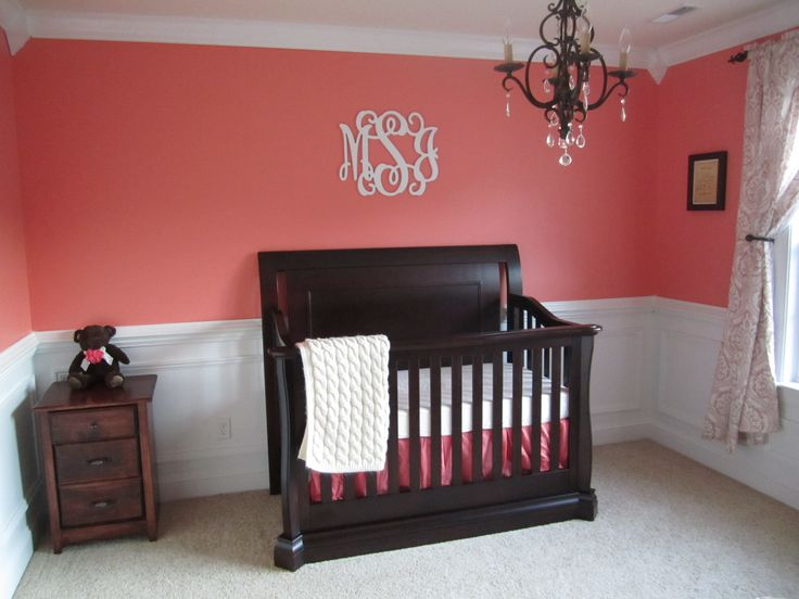 """Coral baby girl nursery. Coral with black crib. Hubs """"I really like that color""""....wow"""