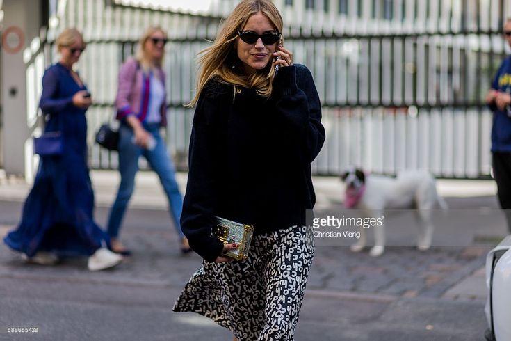 Pernille Teisbaek wearing a Lovechild skirt, Louis Vuitton bag outside Baum und Pferdgarten during the second day of the Copenhagen Fashion Week Spring/Summer 2017 on August 11, 2016 in Copenhagen, Denmark.
