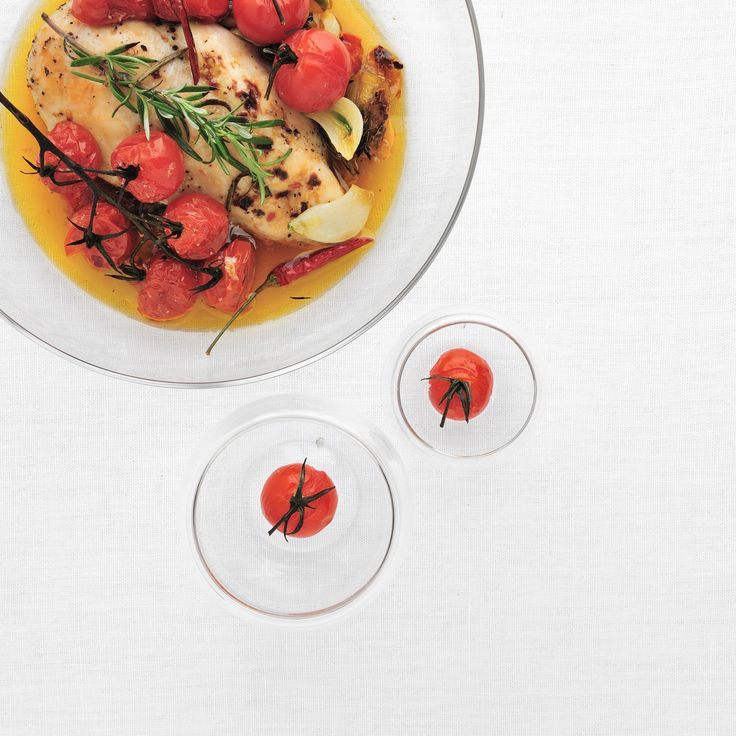 Honey-Rosemary Chicken with Cherry Tomatoes - The cherry tomatoes add a touch of color and flavor to this honey-soaked chicken. http://www.foodandwine.com/recipes/honey-rosemary-chicken-cherry-tomatoes