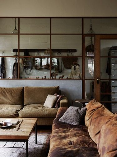 earthy tones and beautiful big metal windows