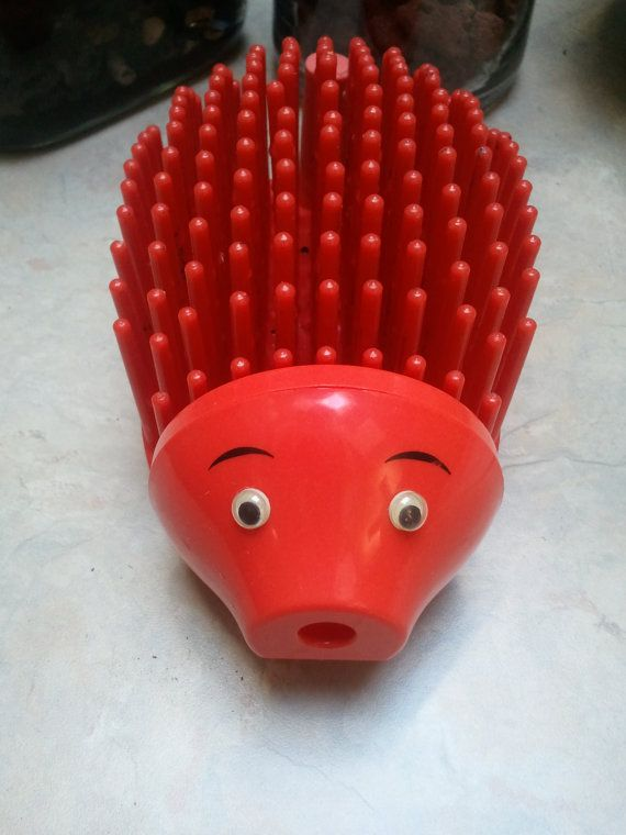 My brother and I both used to have porcupine pencil holders. Mine was yellow or green. I remember them being cuter but this is the only pic I can find. Vintage Plastic Hedgehog Pencil Holder by TheBlackClowder on Etsy