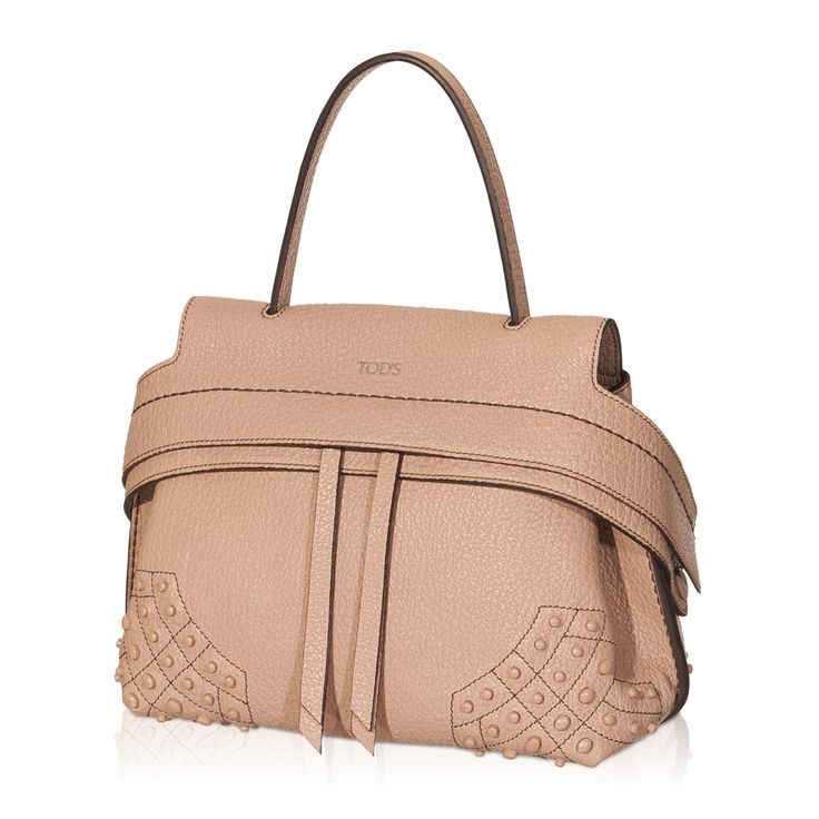 Tod's Wave Mini Bag in tumbled leather with alcantara lining, wide front band with snap fastening on the sides concealing a double slide zipper, removable strap, rubber pebbles on the bottom and back pocket. An innovative design enhanced with luxury distinctive features to create the ultimate cosmopolitan bag.