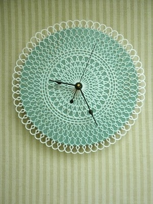 Tatting made into a clock.  Something to make, use and then pass on to next generation.  Who doesn't need/want  a clock?