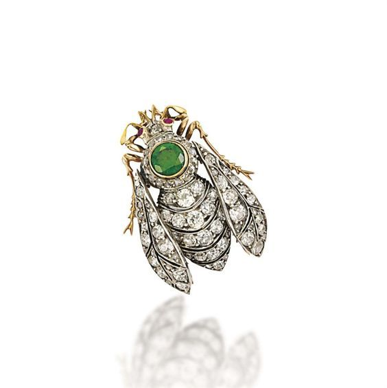 c.1890  DEMANTOID GARNET AND DIAMOND BROOCH Modelled as a bee, the pierced abdomen and wings entirely set with old and rose-cut diamonds, to the circular-cut demantoid garnet thorax with rose-cut diamond surround, the head with ruby single-stone eye detail, mounted in silver and gold,