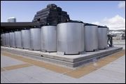 Four dozen cooling units on the roof of Nordstrom at Ala Moana Center are being used to provide air conditioning to the store. The 1,700-gallon thermal tanks create and store ice.     The three-story store will use about half the electricity of a similar sized retailer during day-time hours.