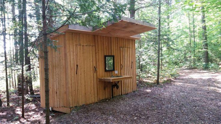 Outdoor washroom and shower for glamping guests at Pura Vida Soul Institute yoga retreat in Muskoka. Www.puravidamuskoka.com