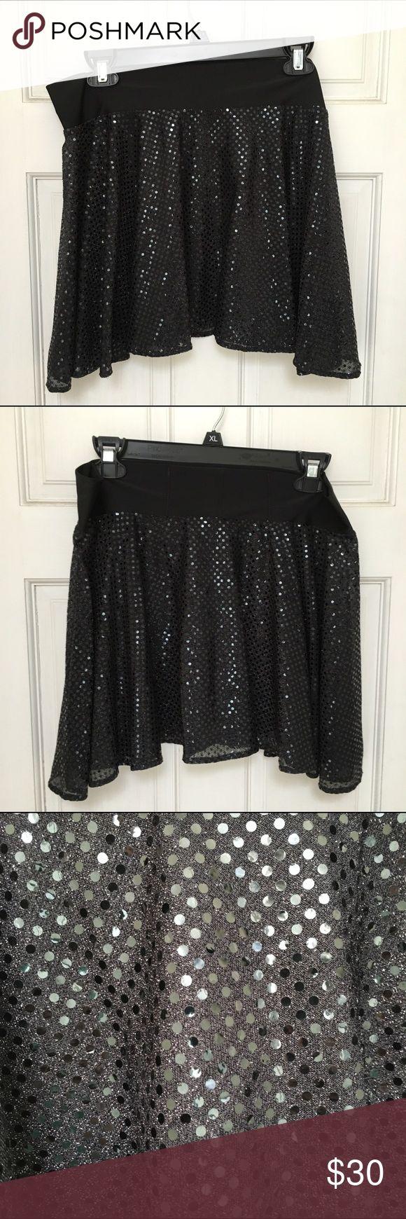 Sparkle skirt size XL. Worn once for a race. Sparkle skirt size XL. Worn once for a race.  Black sequin like fabric. Stretchy waistband. Has secret pocket inside back waistband for a key, money etc. Great to wear at a race! Sparkle Skirts Skirts Mini