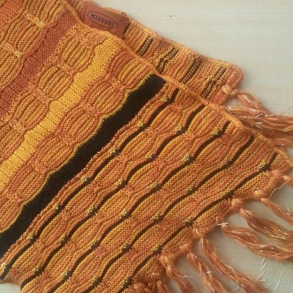 Gorgeous Missoni Scarf Gorgeous extra long Missoni scarfs with gold metallic threads, in excellent condition, has one snag. Missoni Accessories Scarves & Wraps