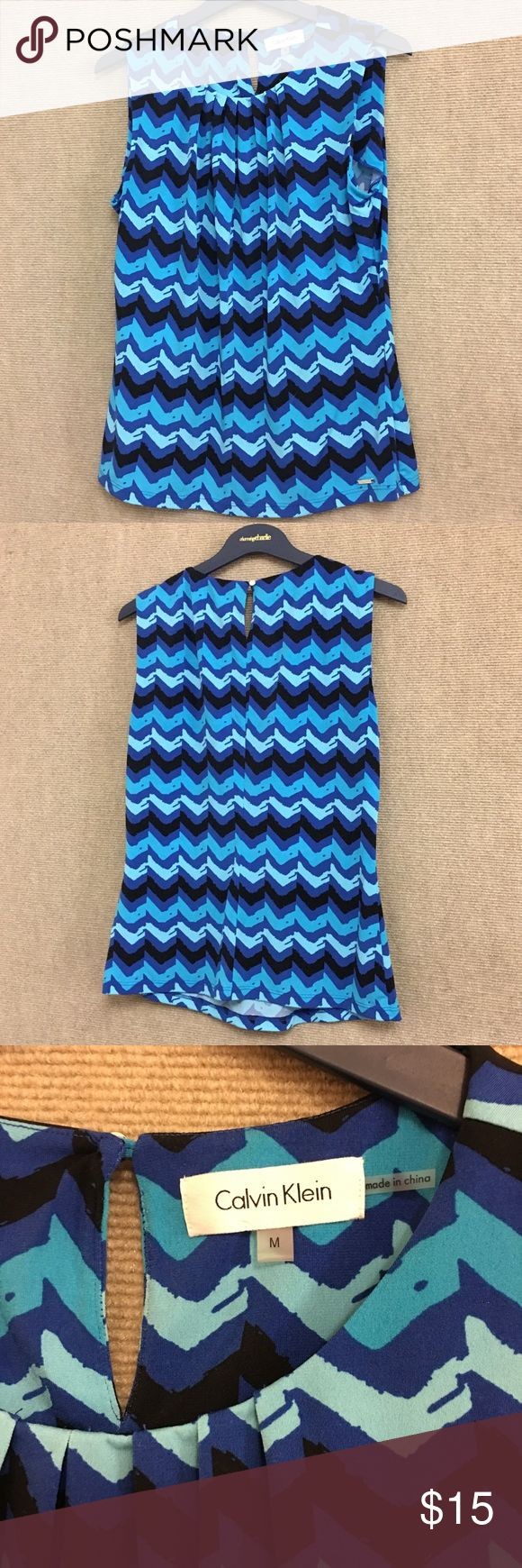 Calvin Klein Pleated Blue Chevron Top Calvin Klein Pleated Blue Chevron Top, excellent condition! Perfect for the warmer months approaching or for the colder months when paired with the perfect cardigan🔥 Calvin Klein Tops Tank Tops