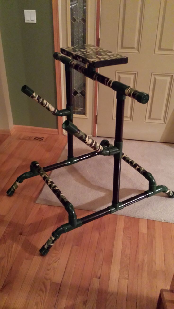 My double stand bow with quivers, a table top to rest ur drinks, an a touch of Camo, everything looks better in Camo..! Made of PVC pipe. U can DIY in 45 min. An under $100 project depending on how you customize it..!