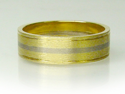 Chibnalls custom made Gents Wedding ring made in 18ct yellow and white gold with hand engraved line detail.